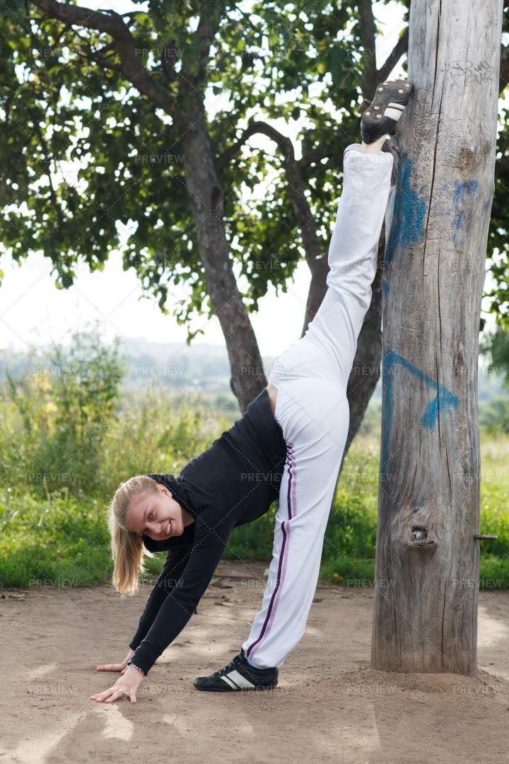 Splits Against A Tree: Stock Photos