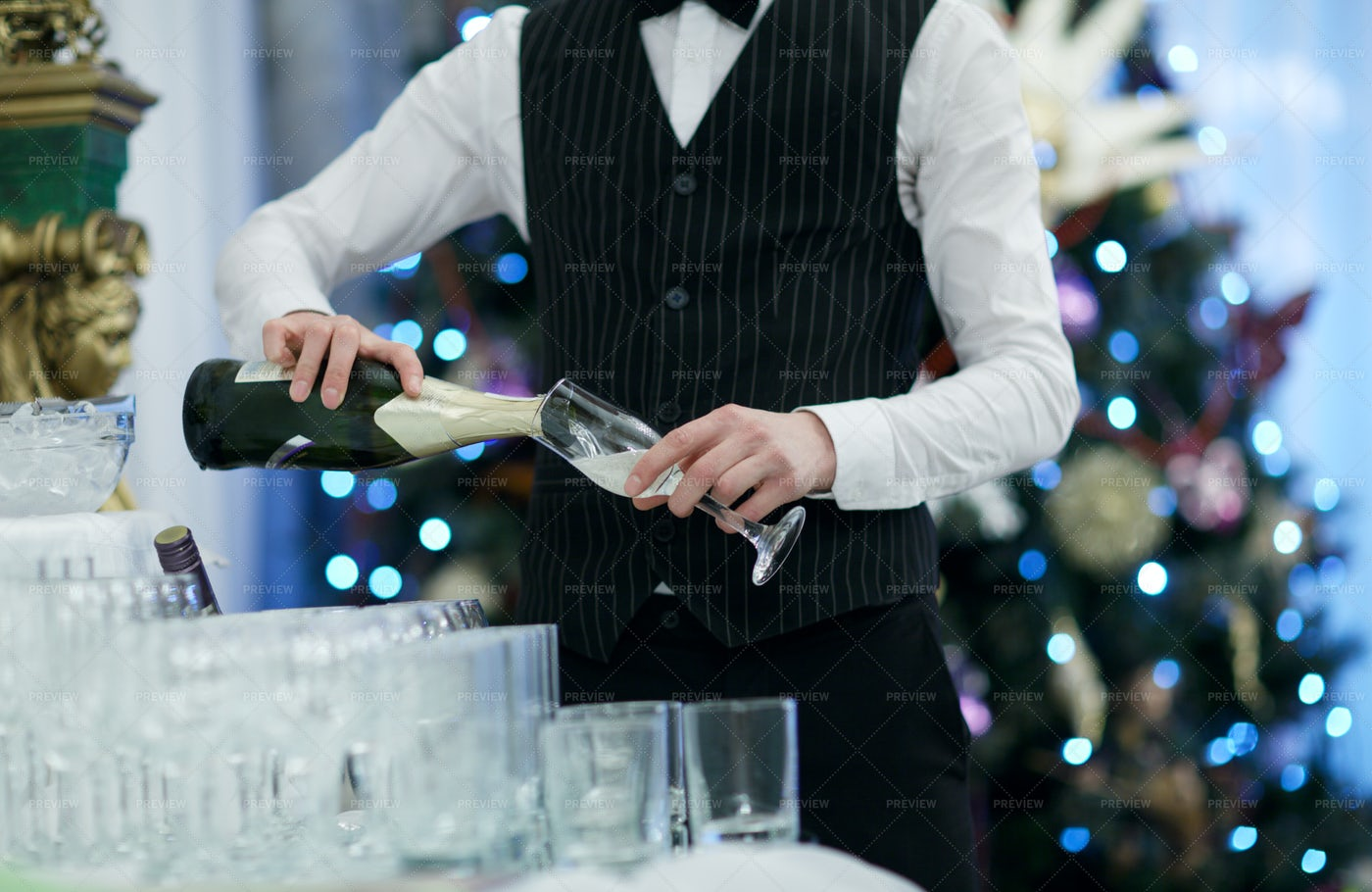 Waiter Pours Champagne: Stock Photos