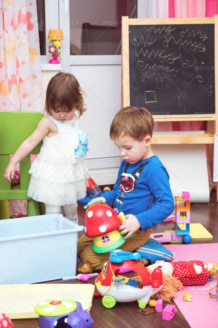 Children Playing With Toys At Home: Stock Photos