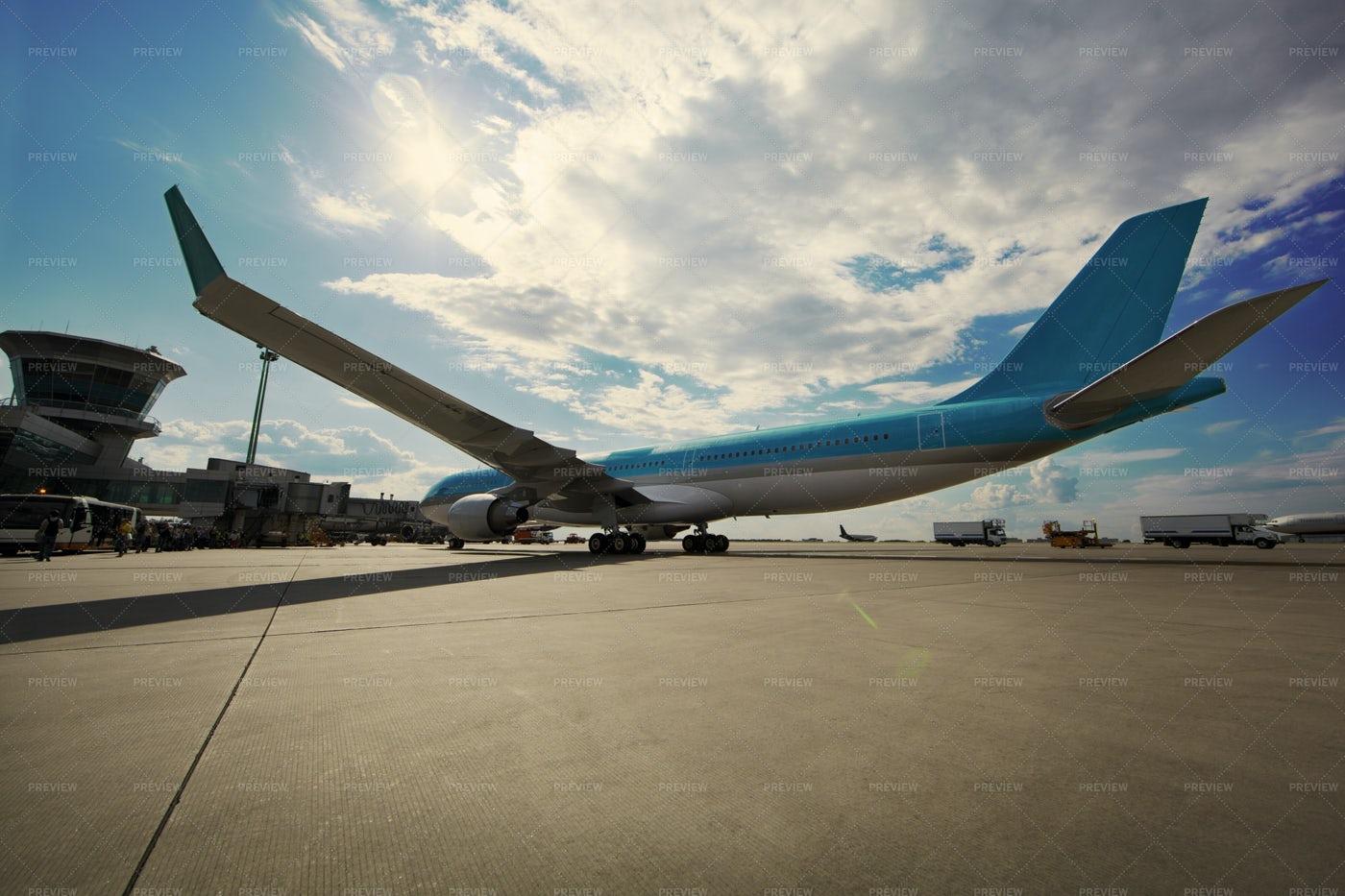 Airplane At The Terminal: Stock Photos