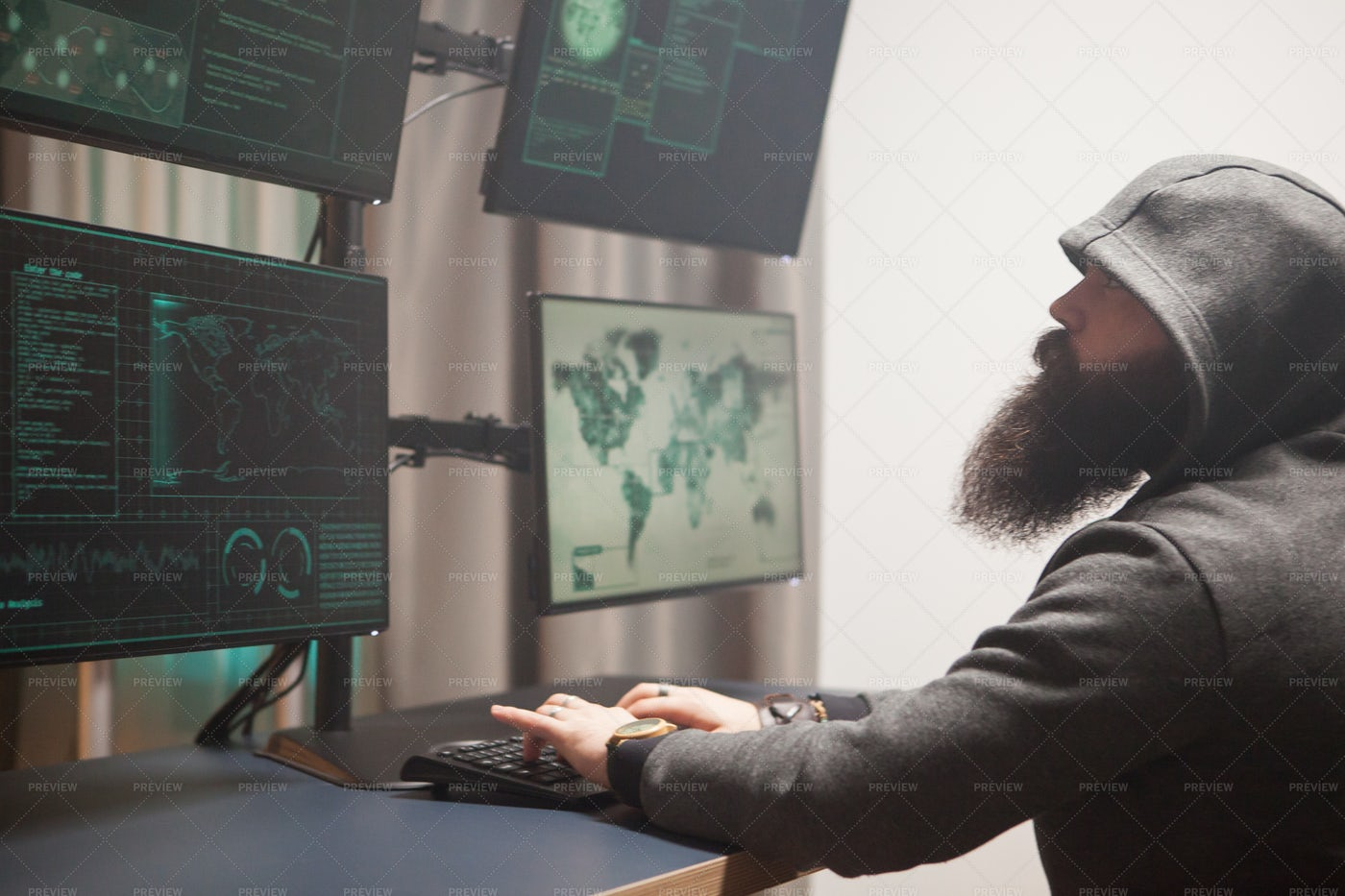 Side View Of Bearded Male Hacker: Stock Photos