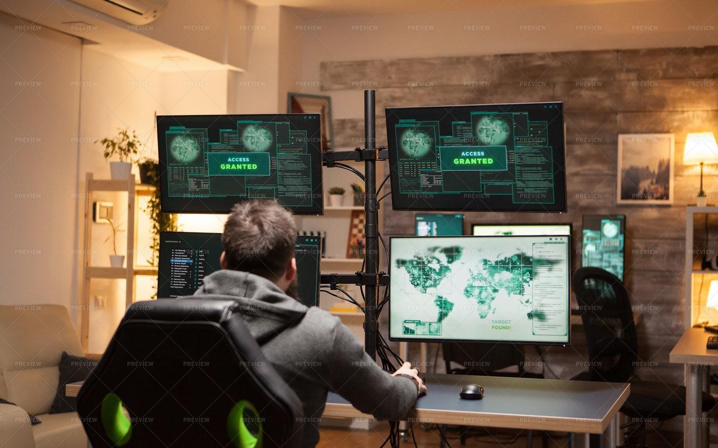 Hacker With Many Screens: Stock Photos