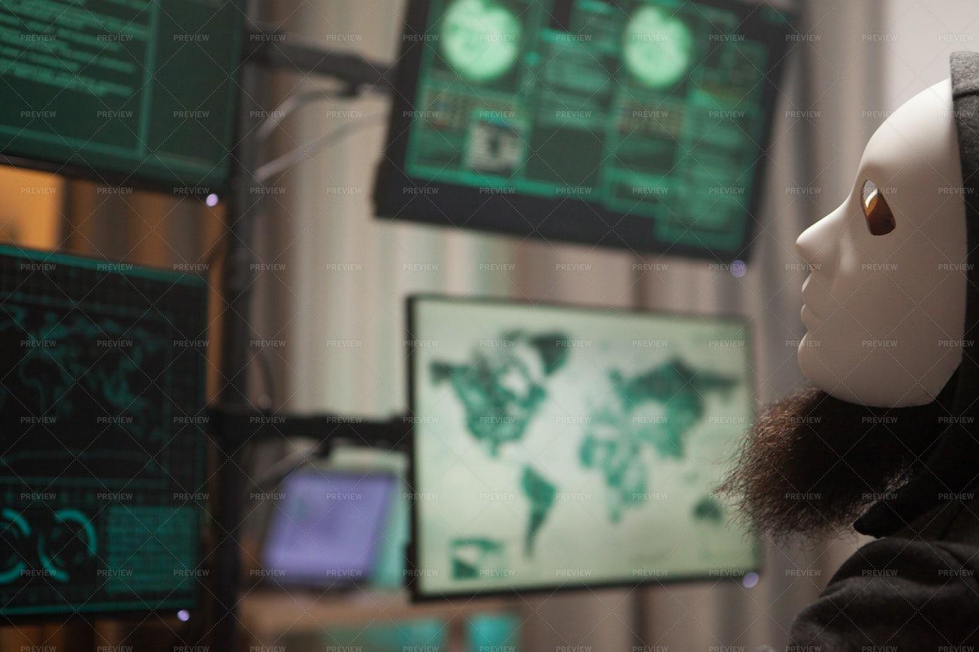 Hacker Wearing A White Mask: Stock Photos