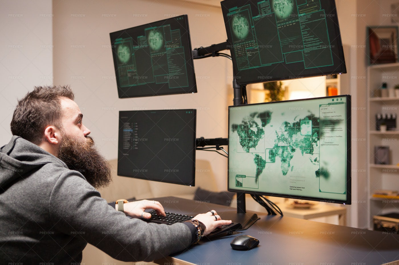 Hacker Conducts Cyber Attack: Stock Photos