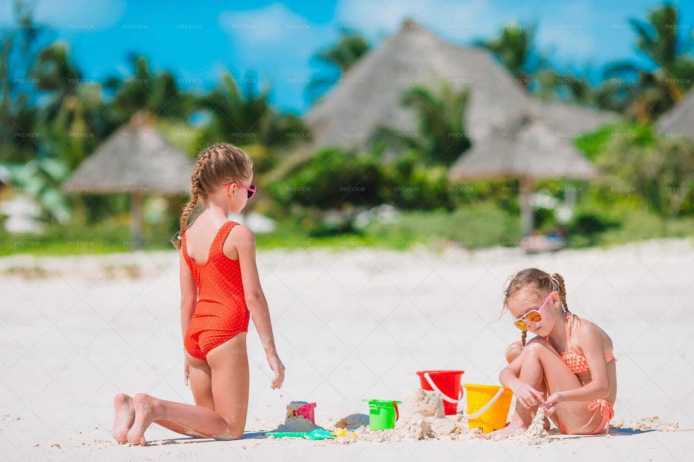 Two Kids Making A Sand Castle: Stock Photos