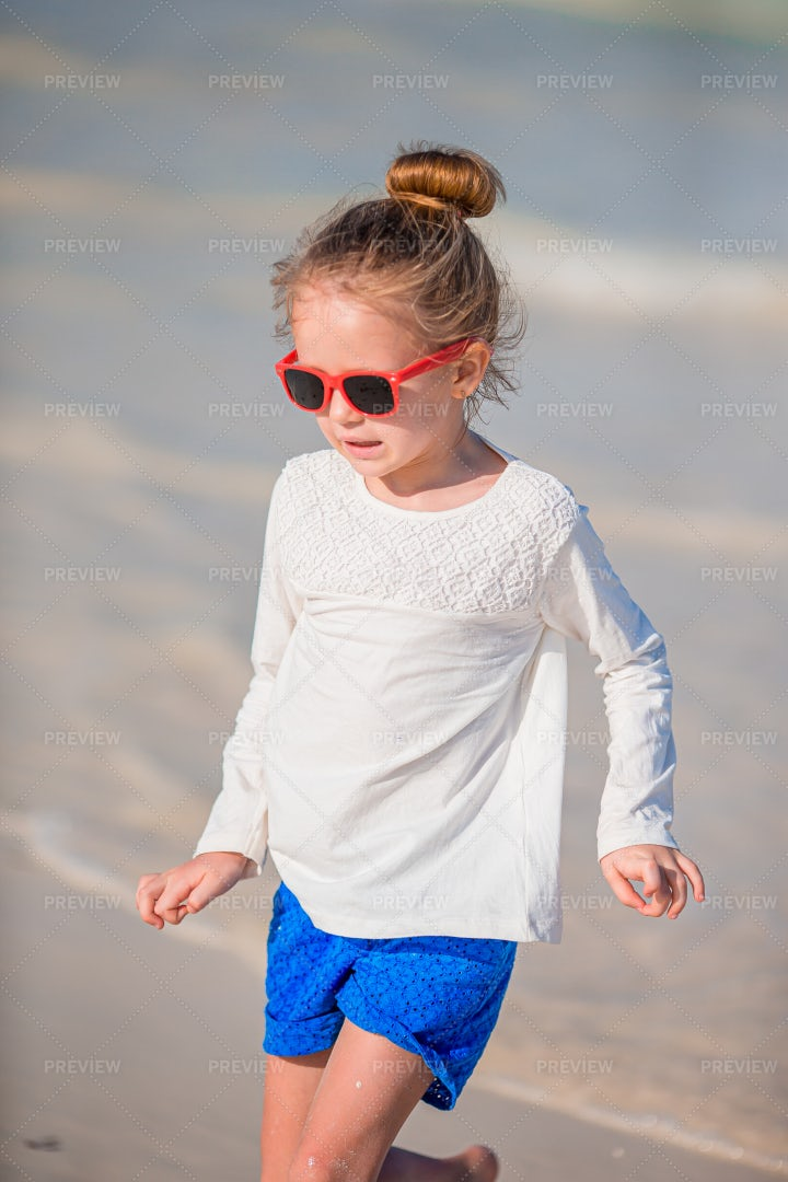 Kid Enjoying The Beach: Stock Photos