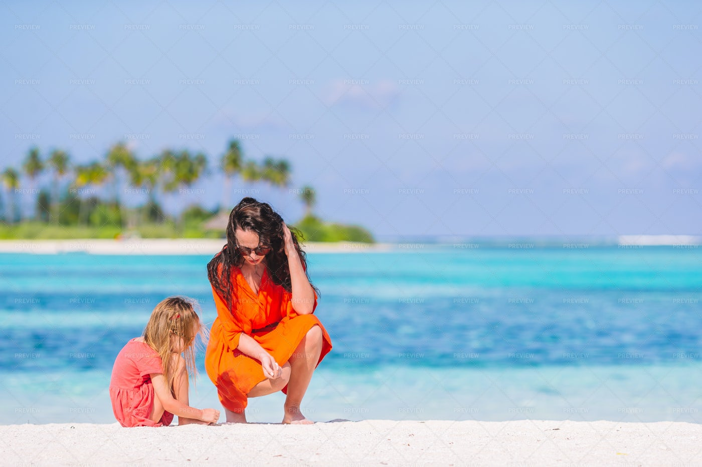 Mom And Daughter On The Beach: Stock Photos