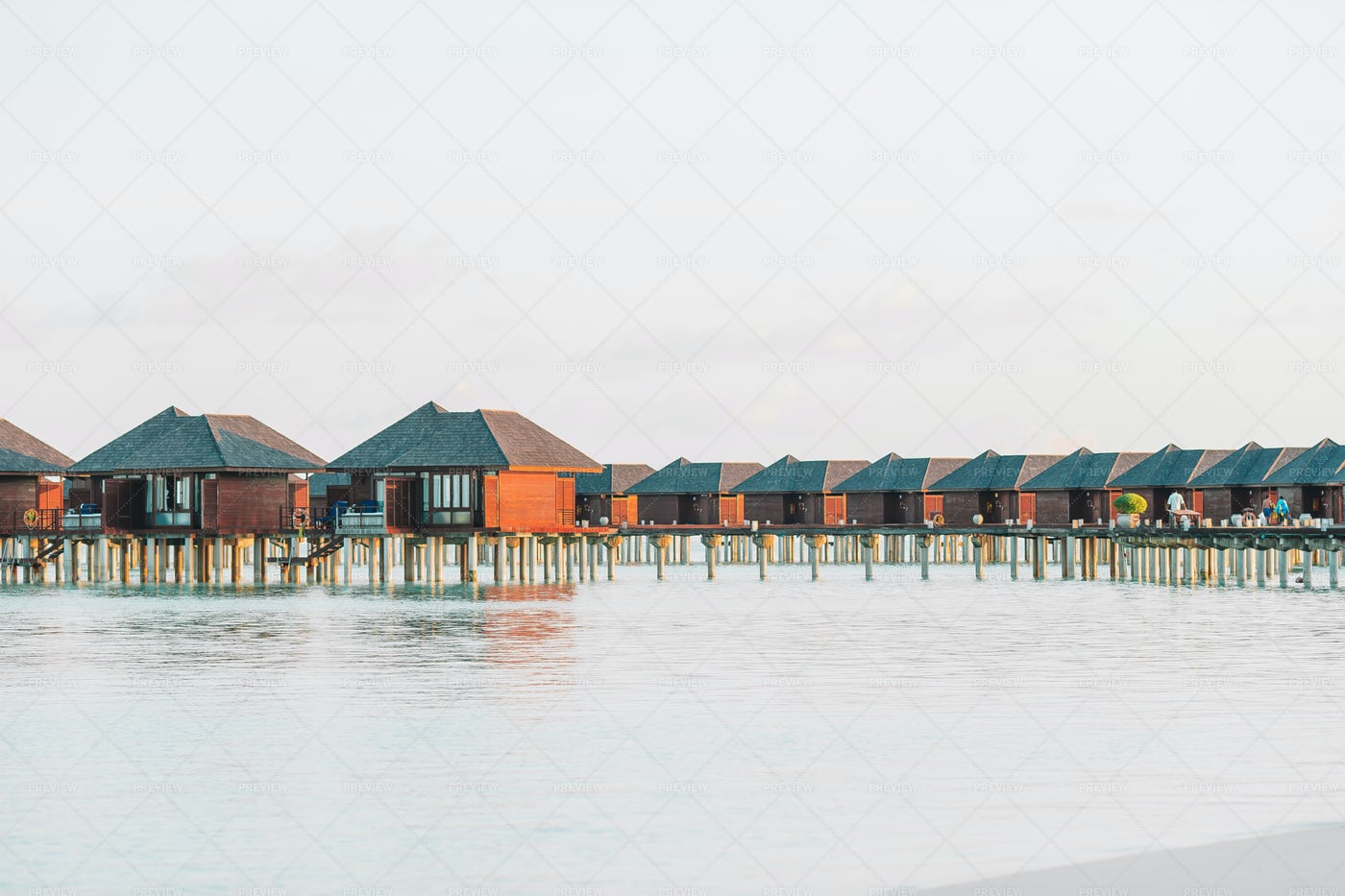 Water Bungalows And Calm Water: Stock Photos