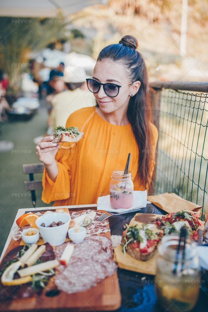 Woman Enjoys Her Breakfast: Stock Photos
