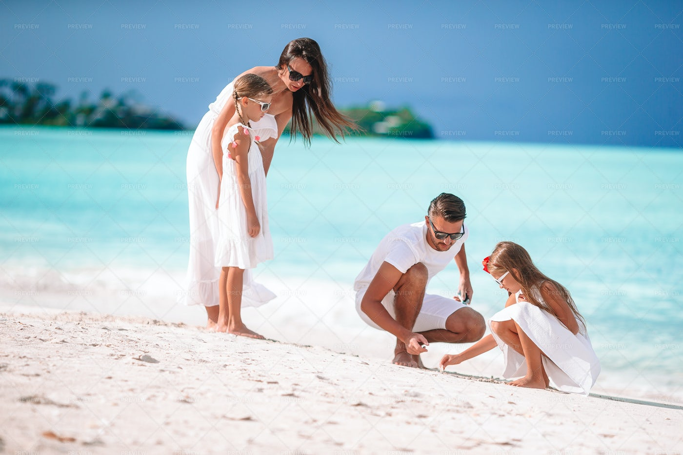 Family Dressed In White On The Beach: Stock Photos