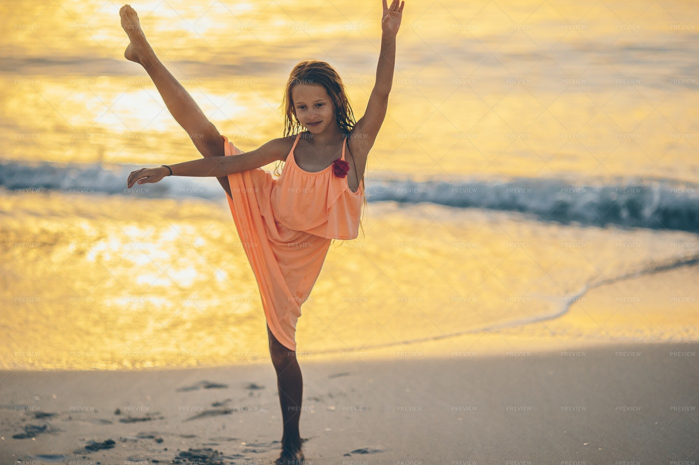 Sporty Little Girl In A Sunset: Stock Photos