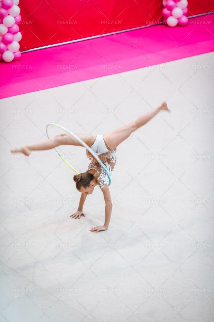 Gymnast Girl Training On The Carpet: Stock Photos