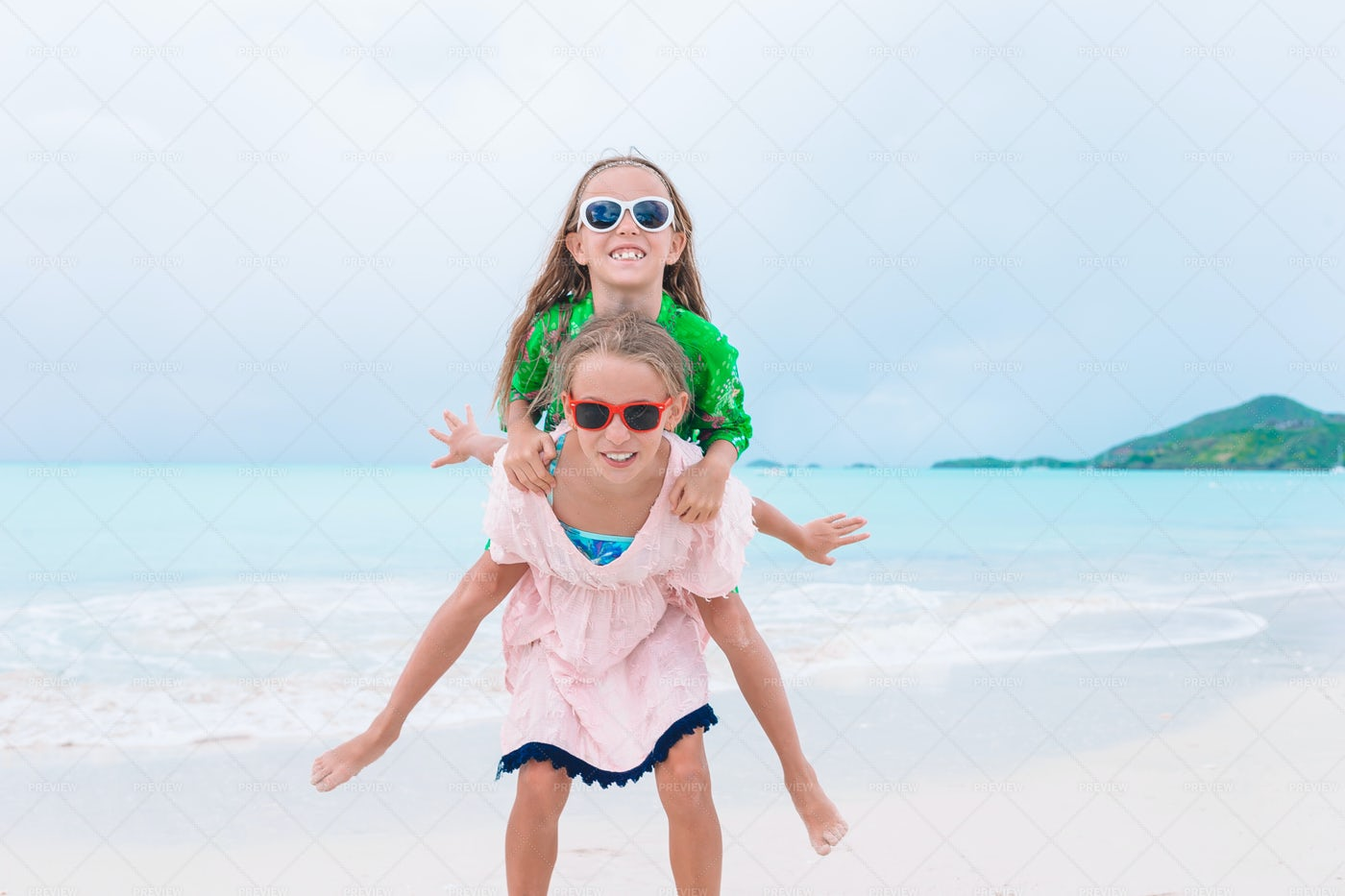 Little Sisters Having Fun In The Sand: Stock Photos