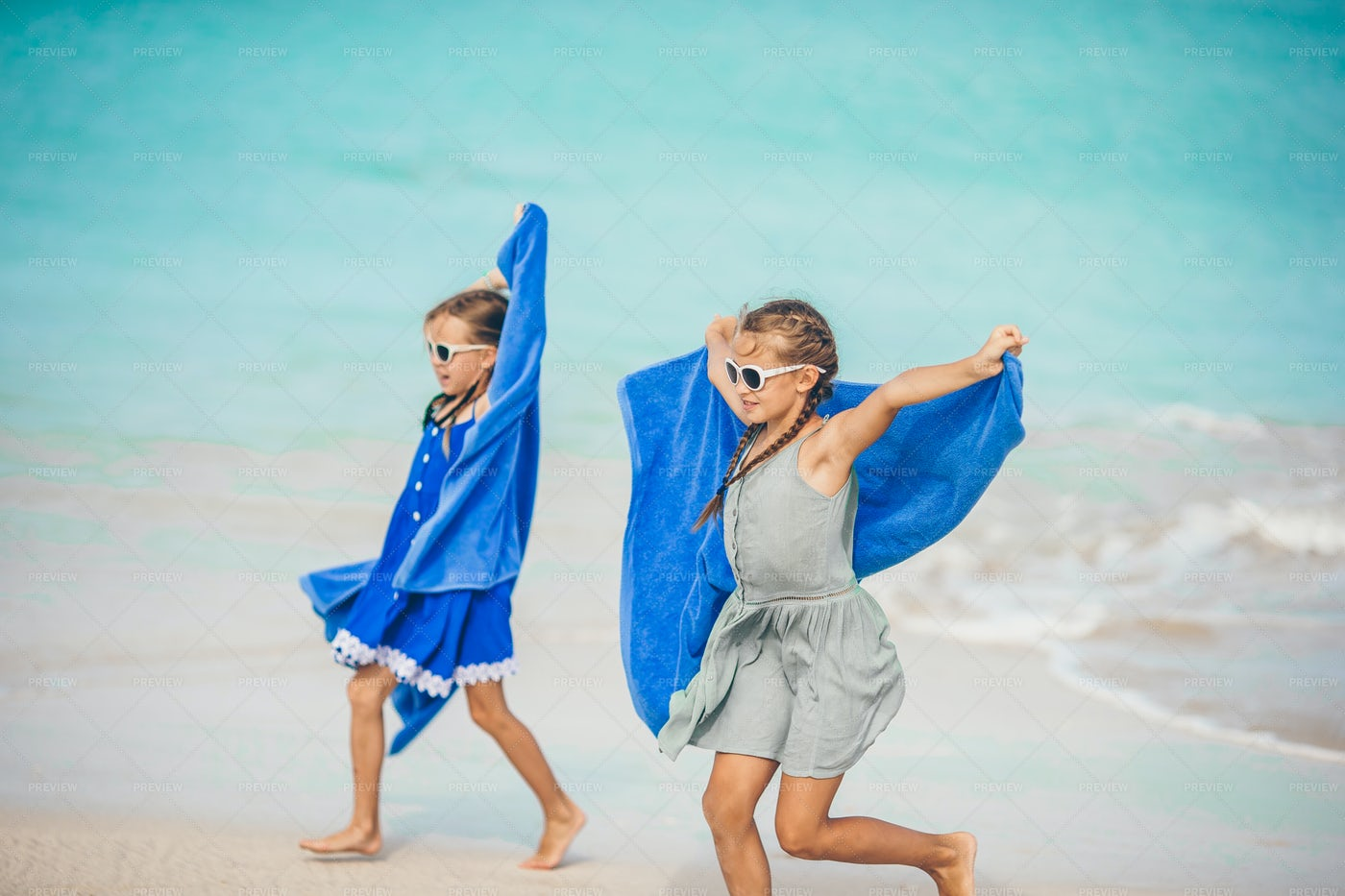 Playing At The Beach With Towels: Stock Photos