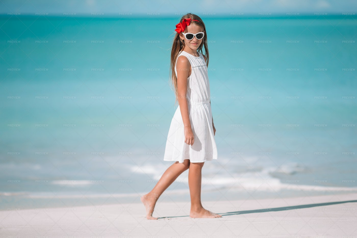 Girl In Front Of The Beach: Stock Photos