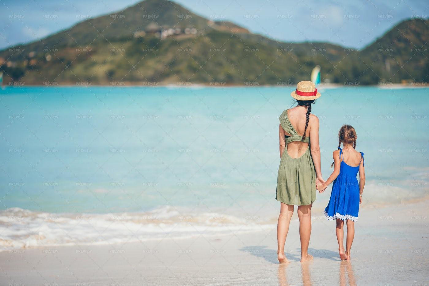 Mother And Daughter At A Caribbean Beach: Stock Photos
