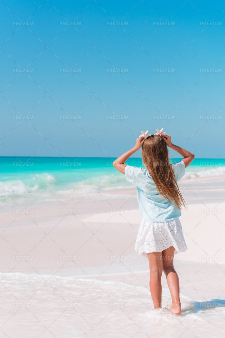 Girl Standing In Front Of The Beach: Stock Photos