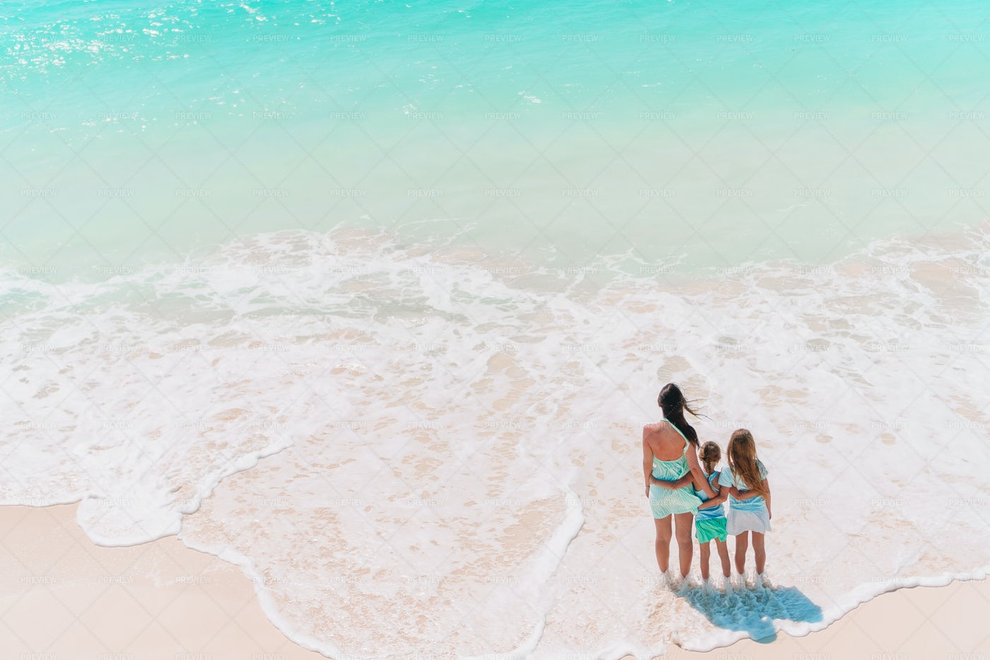 Aerial View Of Family At The Beach: Stock Photos