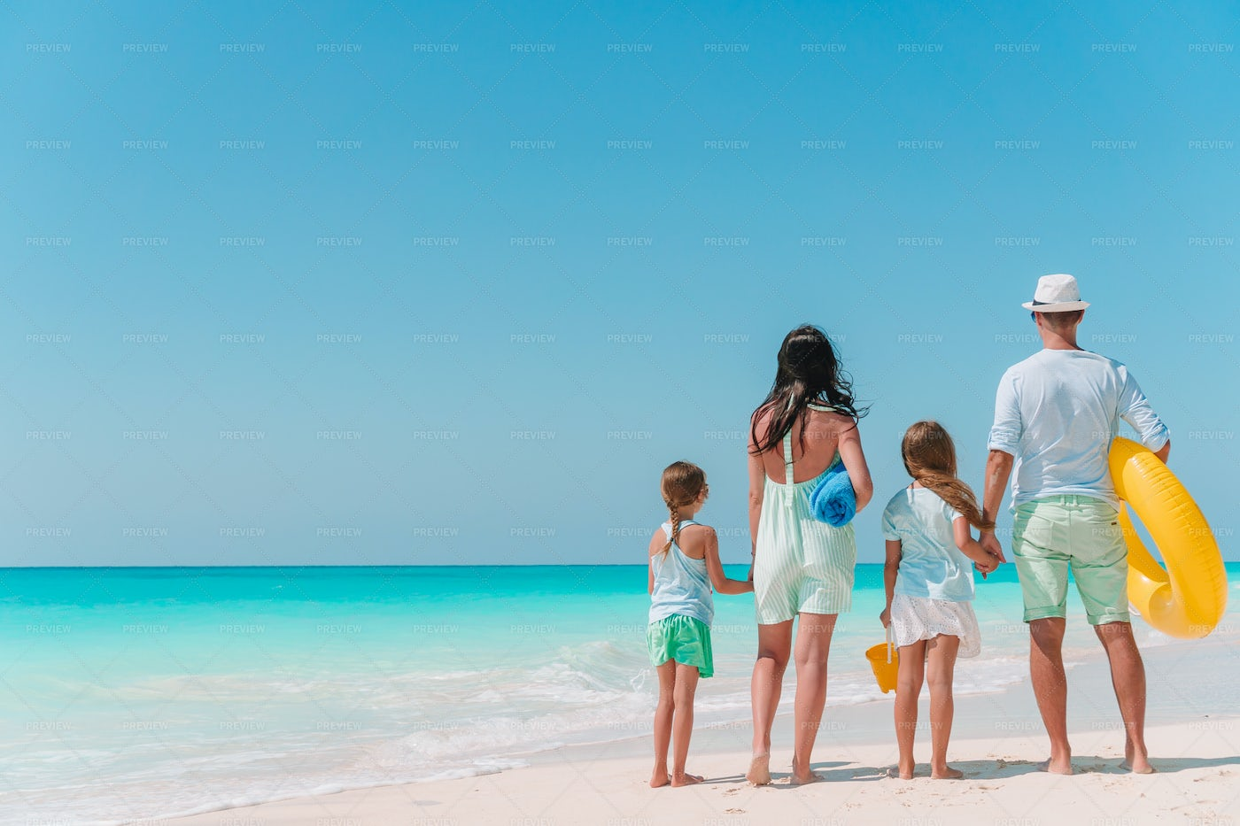 Happy Family With Walking On The Sand: Stock Photos
