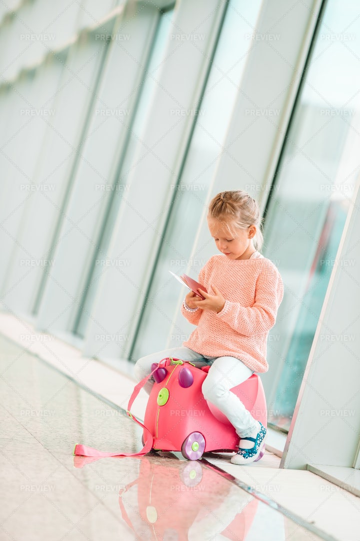Adorable Little Girl In Airport With Her: Stock Photos