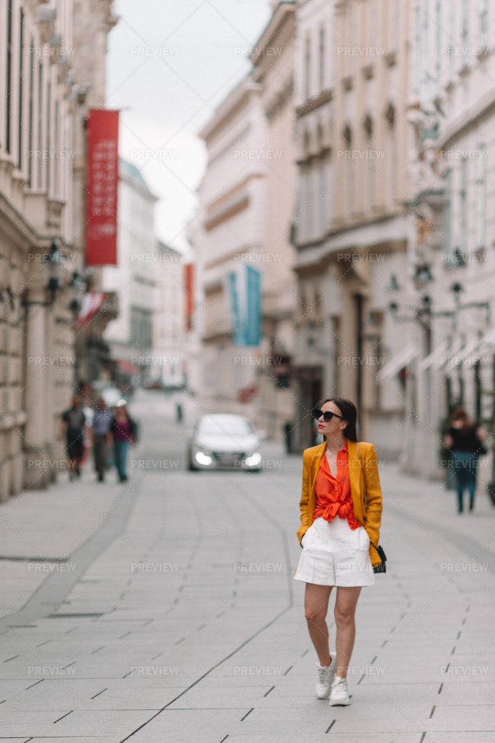 Woman Walking In A City: Stock Photos