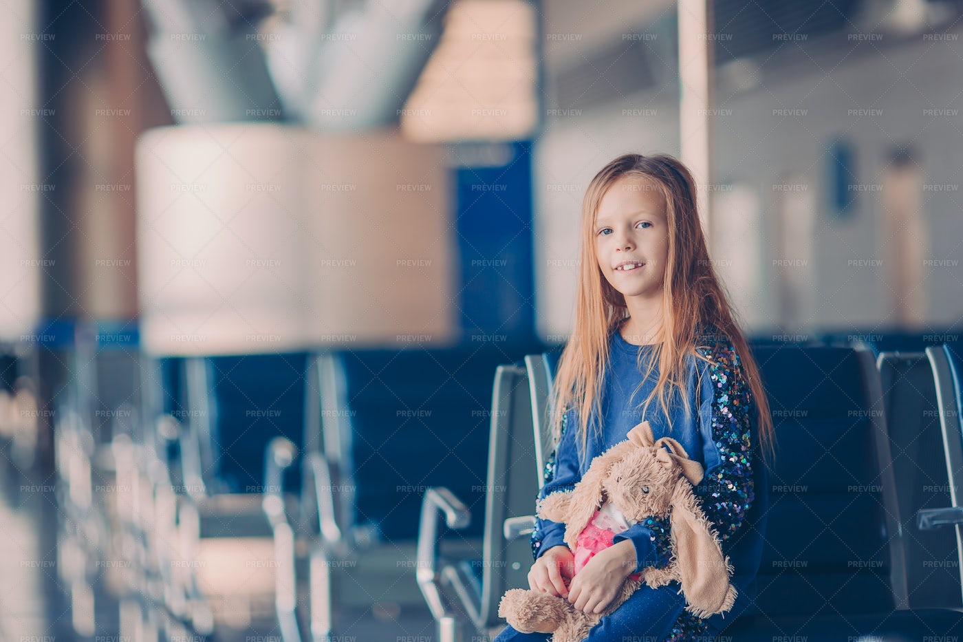Girl Sitting  In Airport: Stock Photos