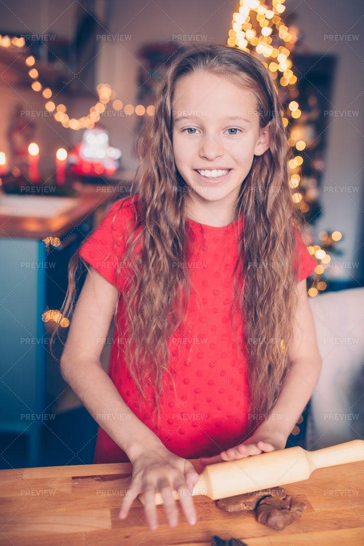 Little Girl Baking Cookies On Christmas: Stock Photos