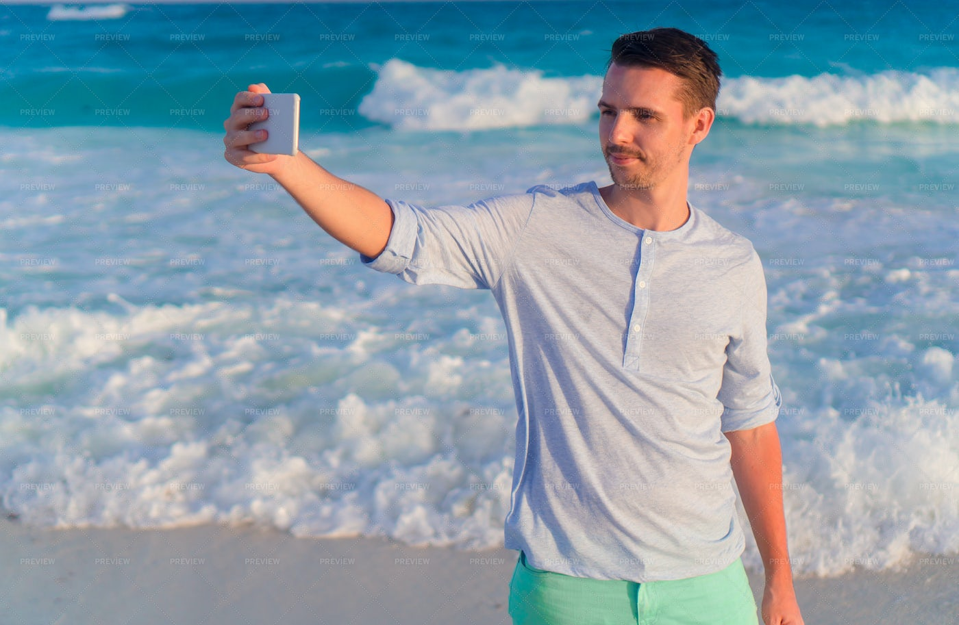Young Man Taking Selfie On The Beach: Stock Photos