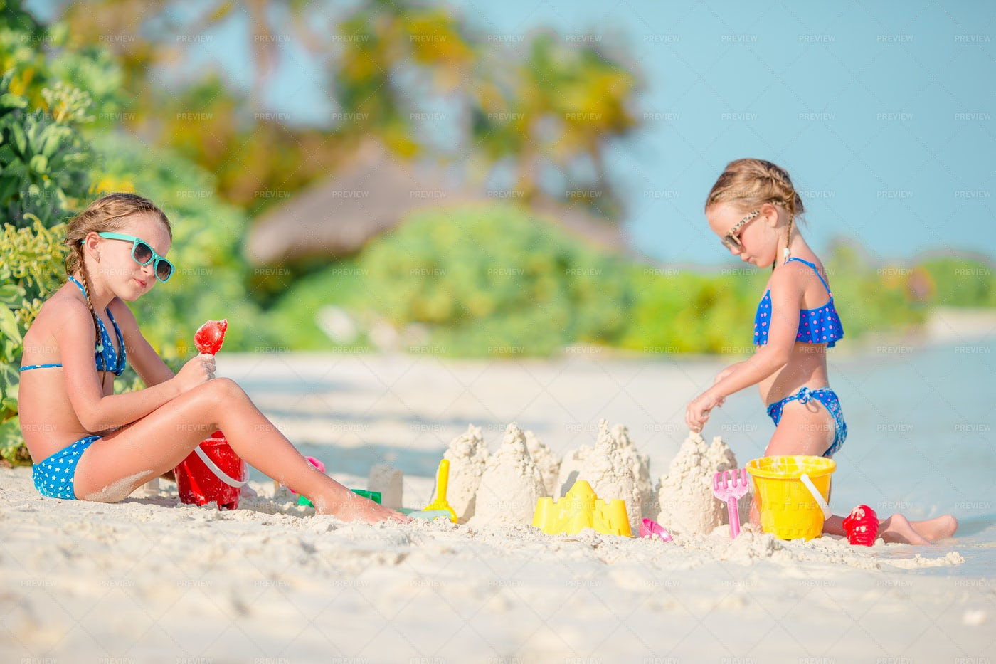 Two Girls Making A Sand Castle: Stock Photos
