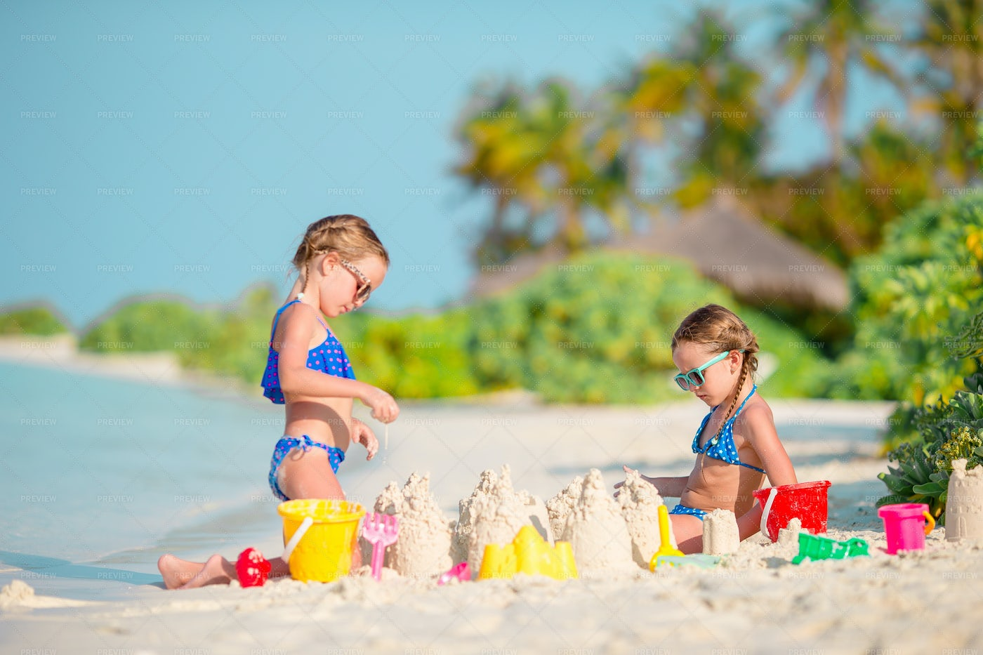 Two Kids Making Sand Castles: Stock Photos