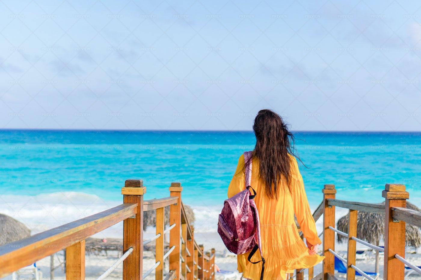 Woman Walking Towards The Coast: Stock Photos
