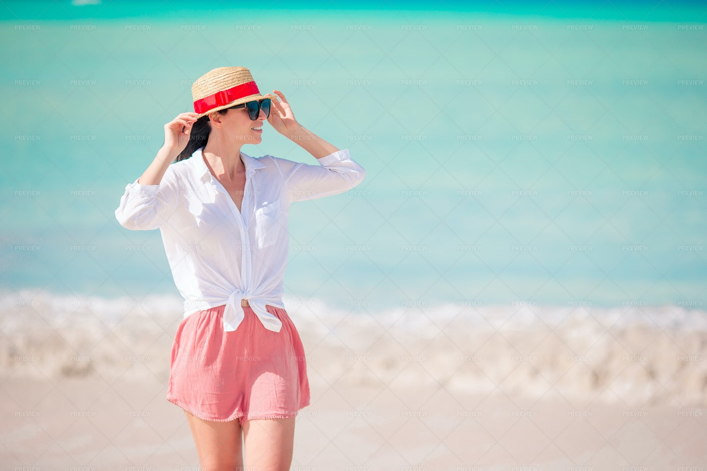 Wearing A Hat On The Beach: Stock Photos