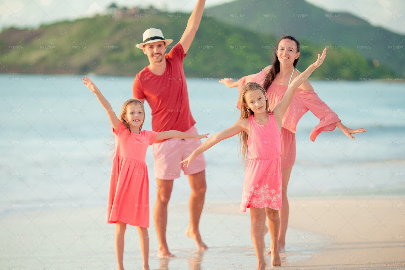 Happy Family With Kids On The Beach: Stock Photos