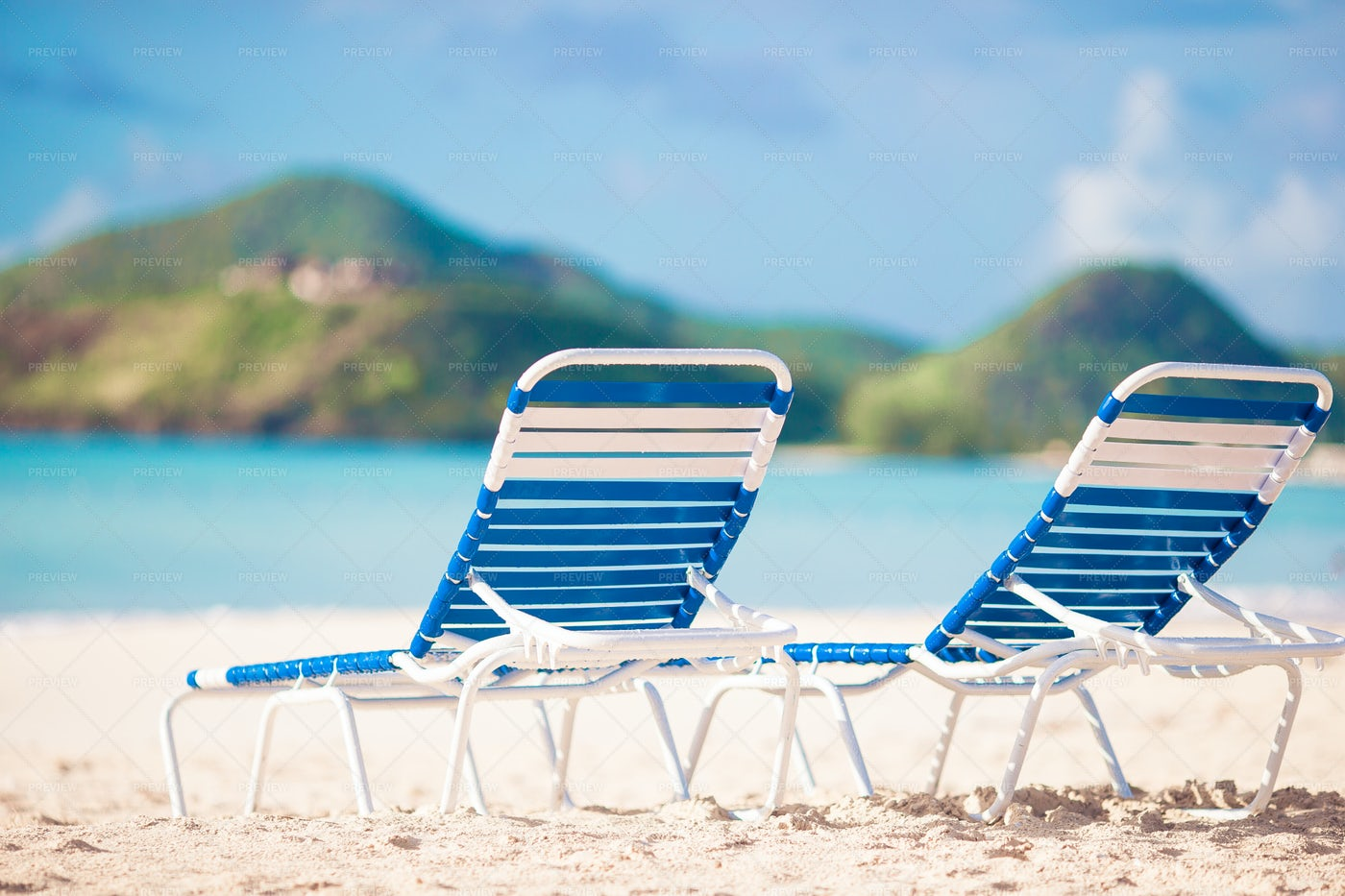 White Lounge Chairs On The Beach: Stock Photos