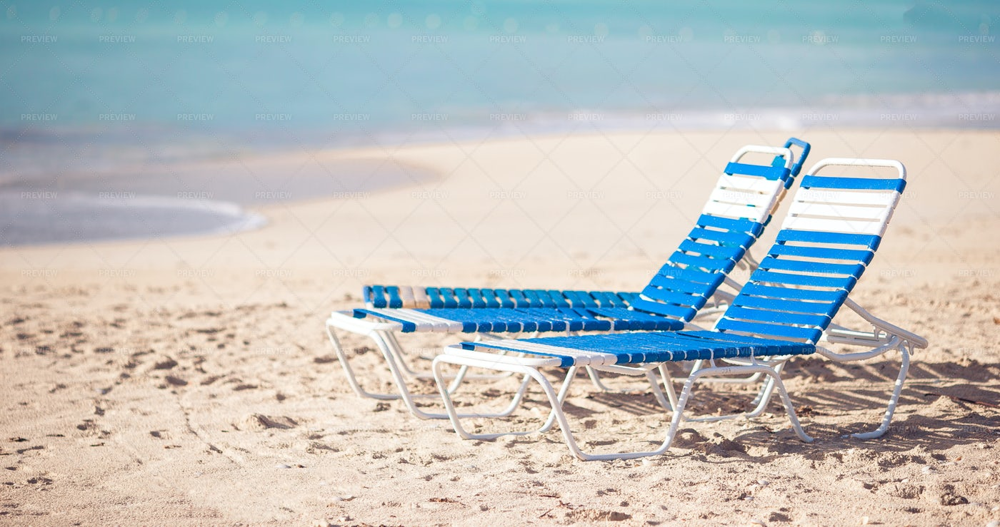 White And Blue Chairs On The Beach: Stock Photos