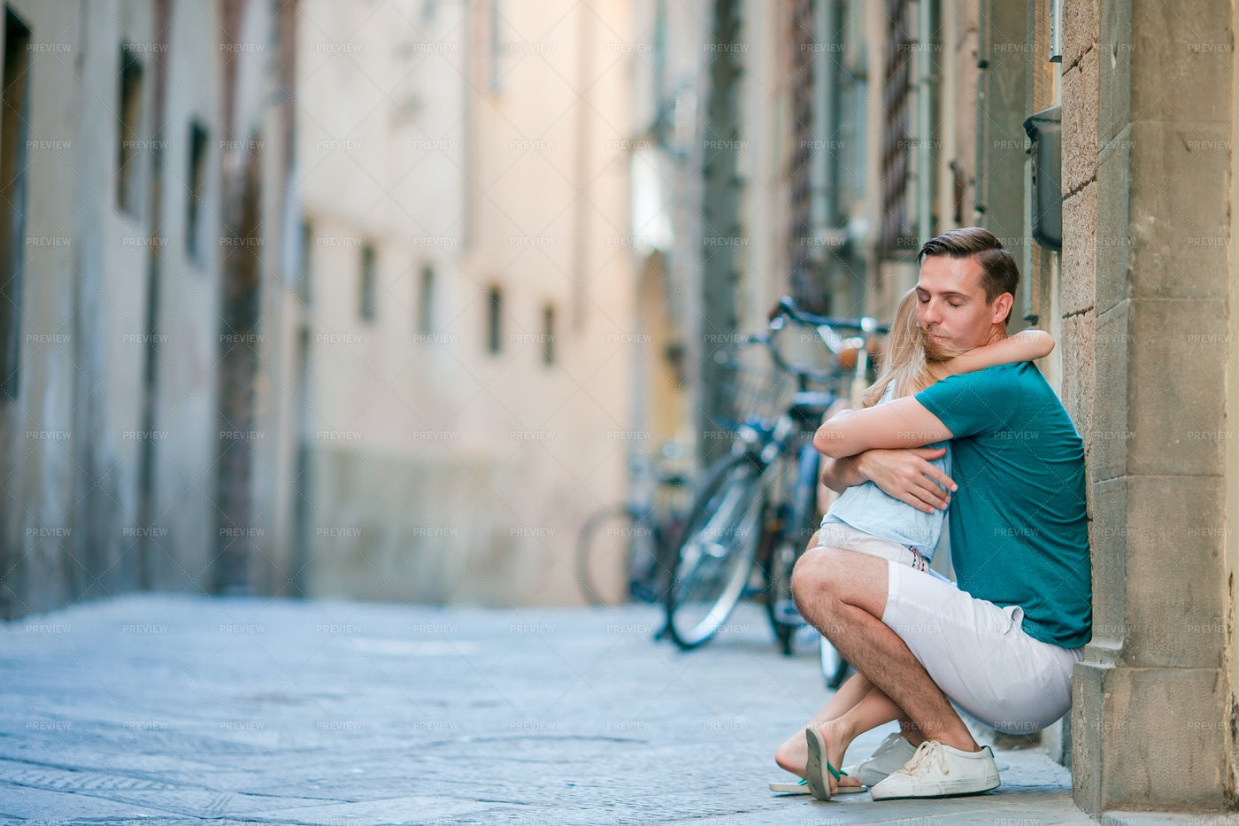 Hugging Her Father In The Street: Stock Photos
