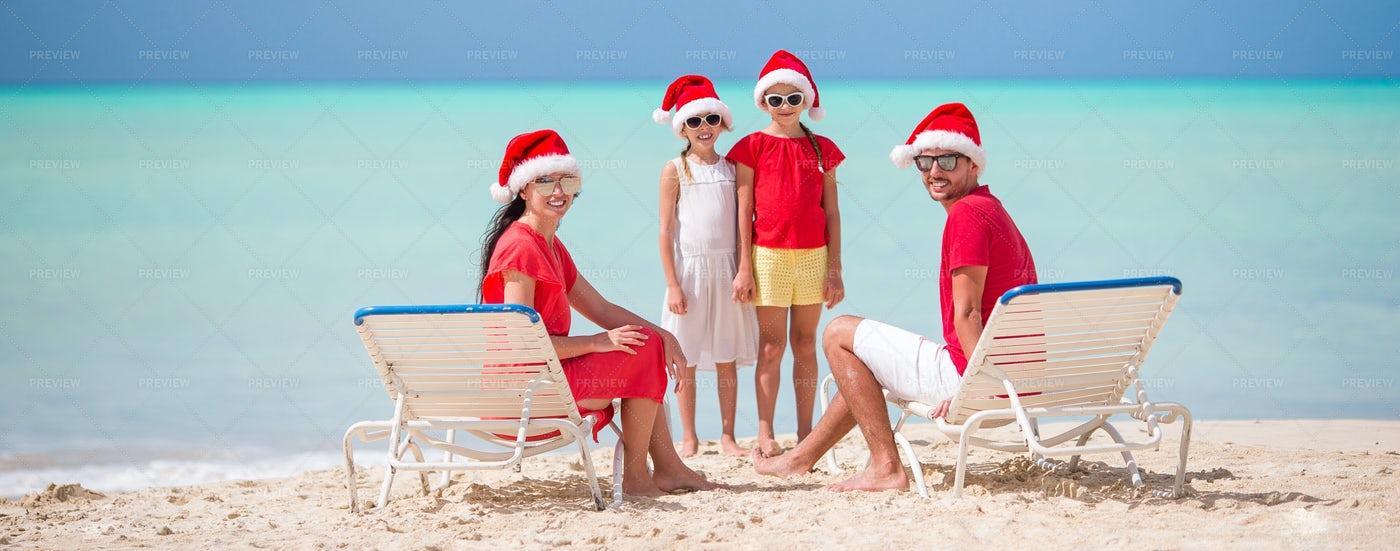 Dressed As Santa On The Beach: Stock Photos