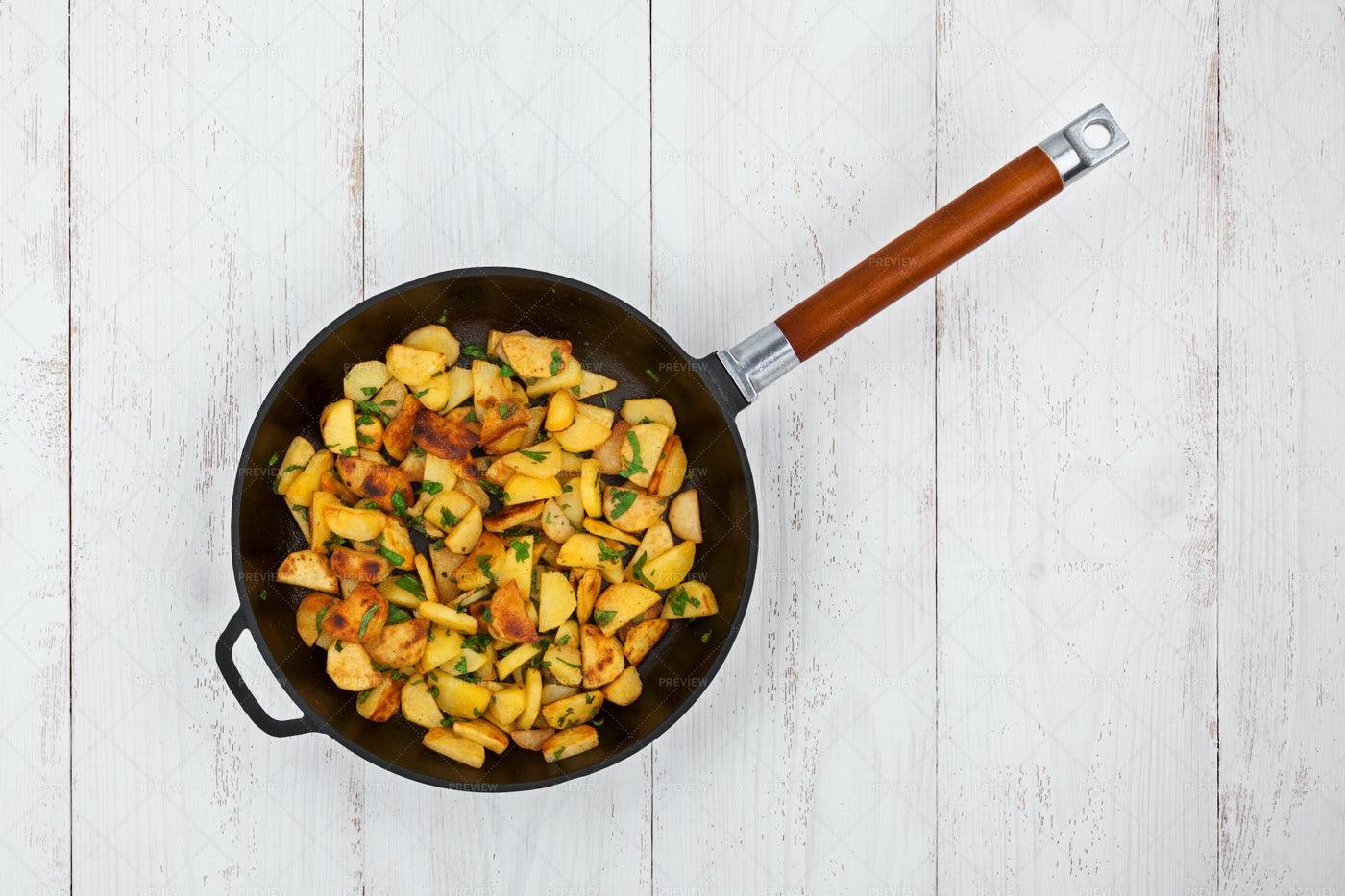 Potatoes In A Frying Pan: Stock Photos