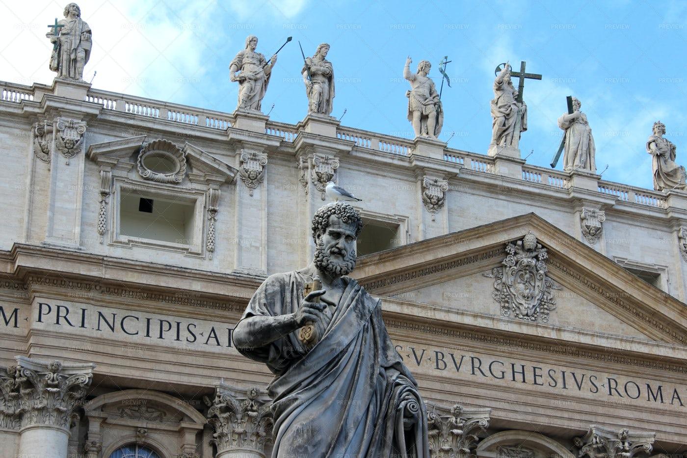St. Peter Statue And Basilica: Stock Photos