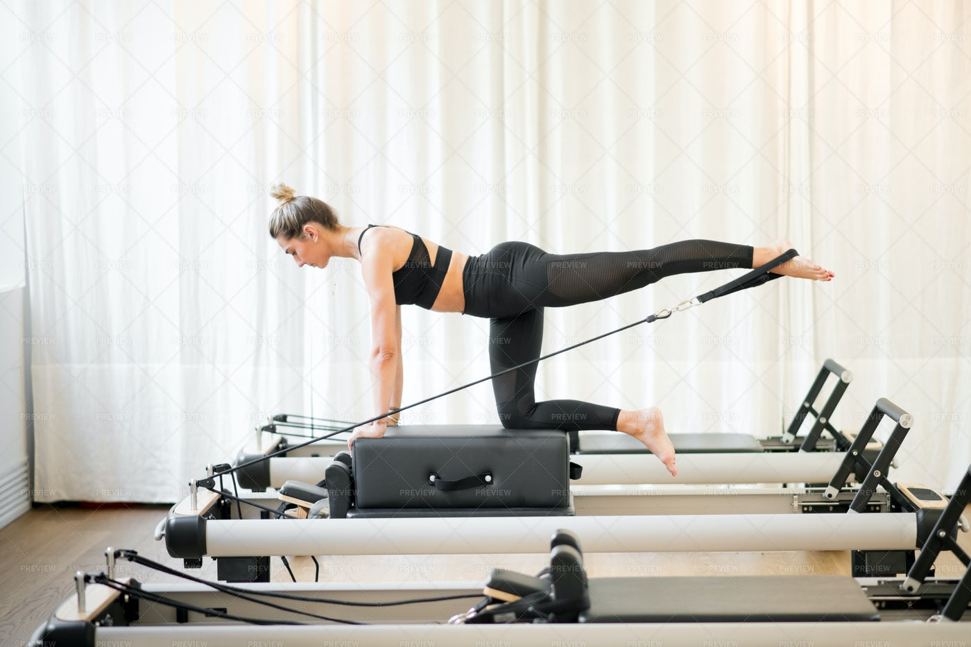 Woman Performing Pilates With A Machine: Stock Photos