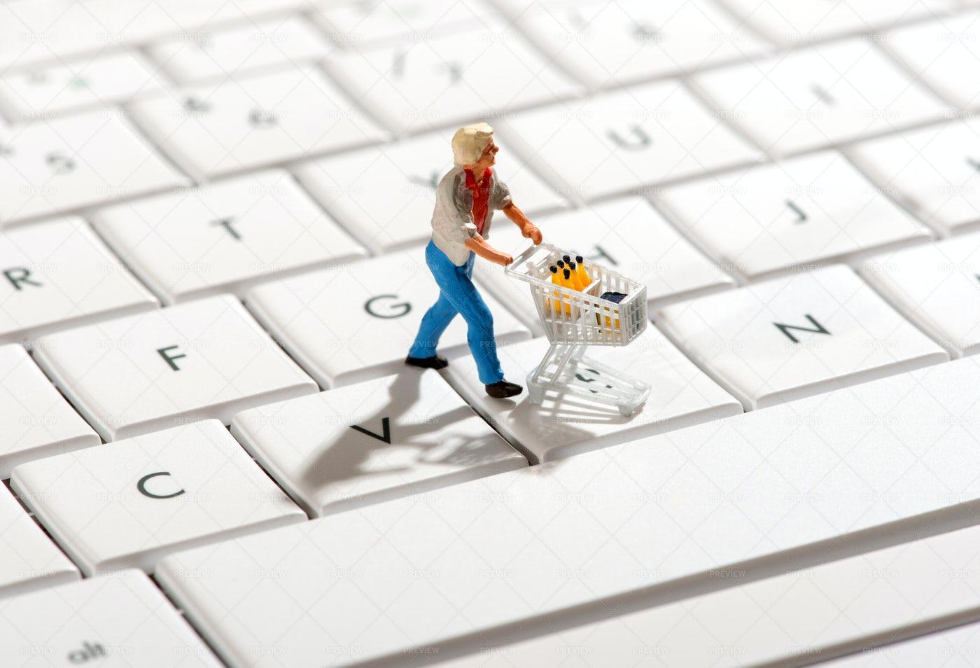 Shopper Pushing A Trolley Over A Compute: Stock Photos