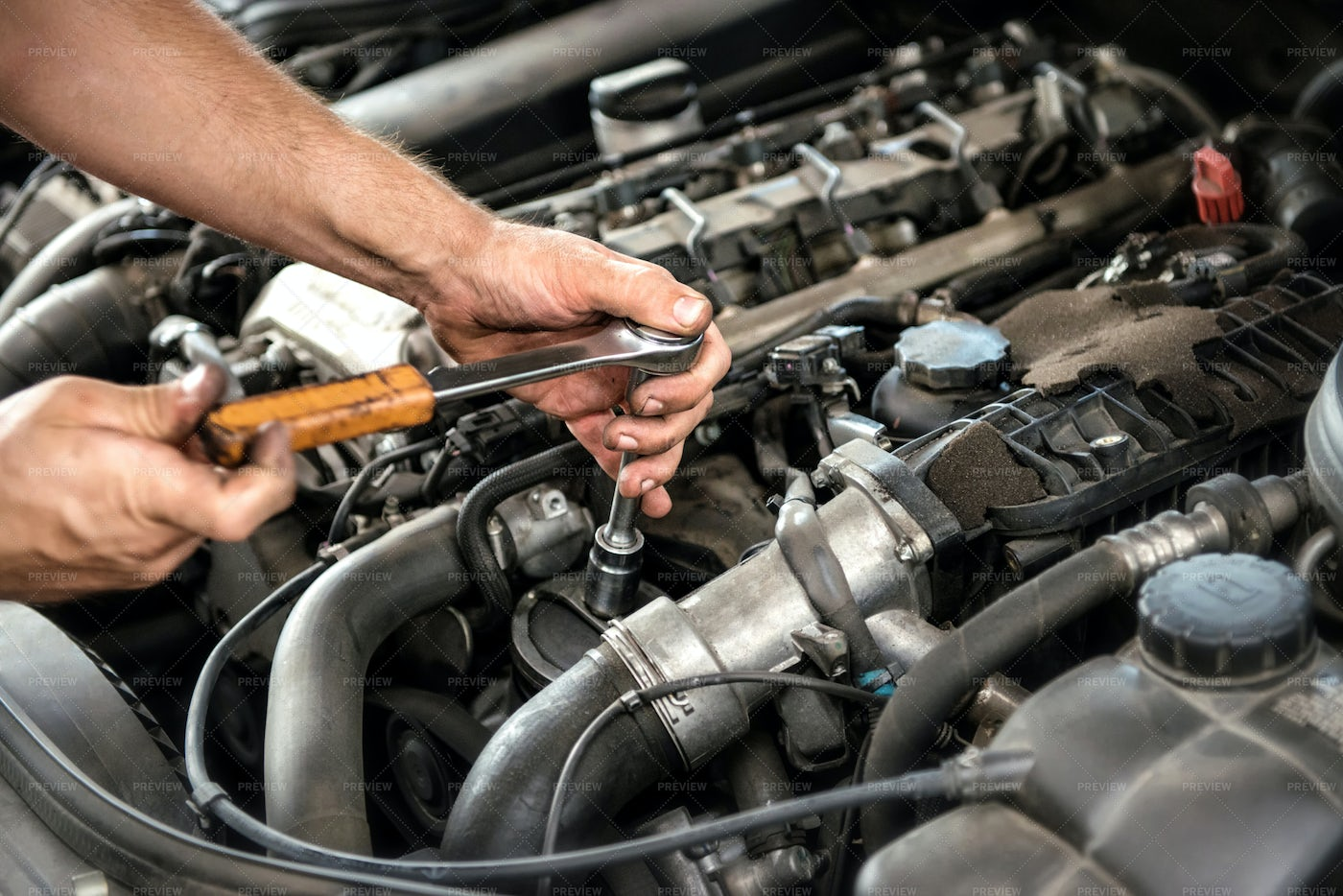 Mechanic Using A Wrench And Socket: Stock Photos