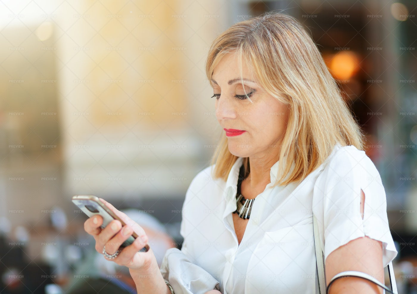 Checking Her Smartphone: Stock Photos