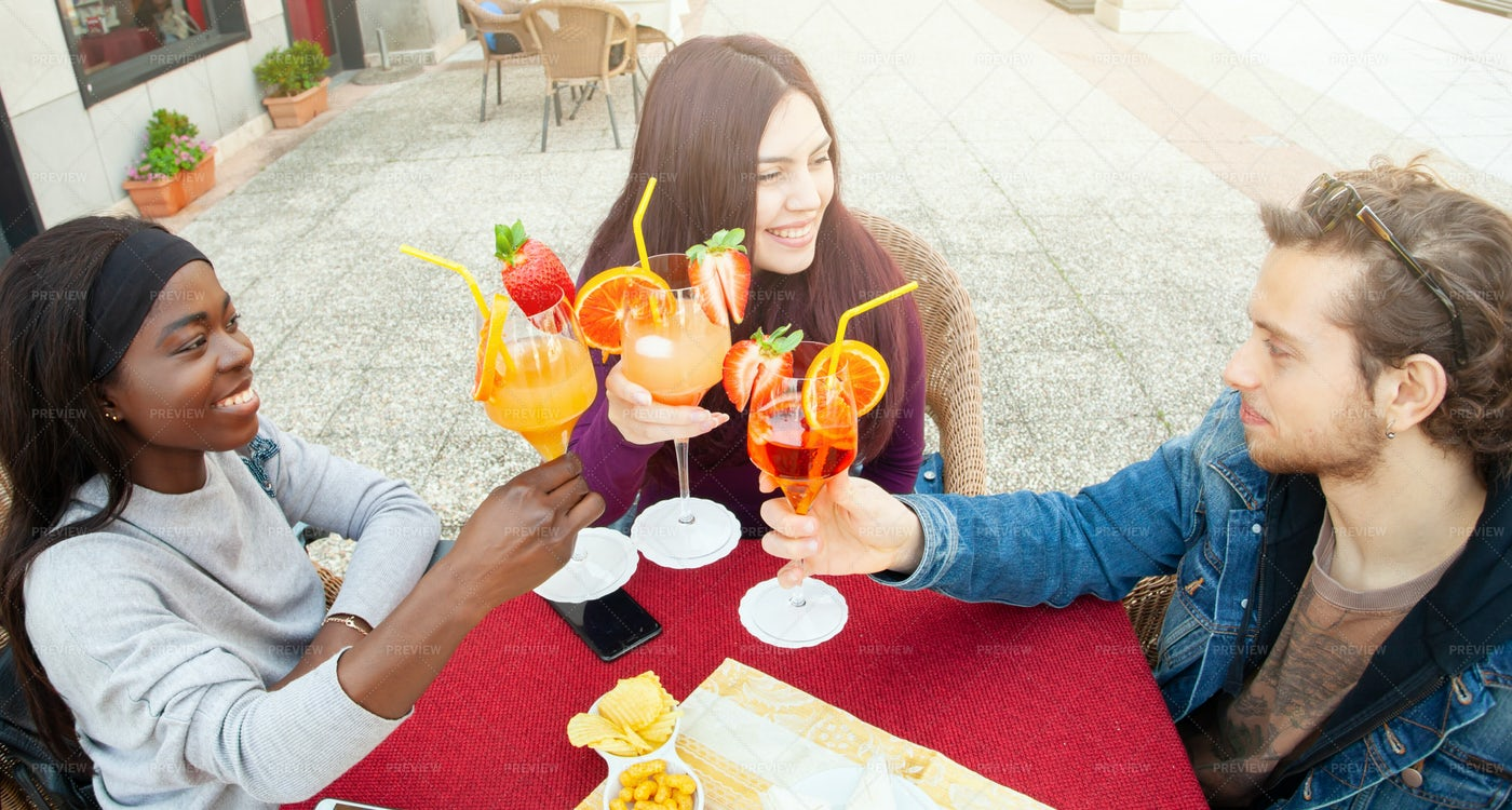 Friends Drinking Cocktails Together: Stock Photos