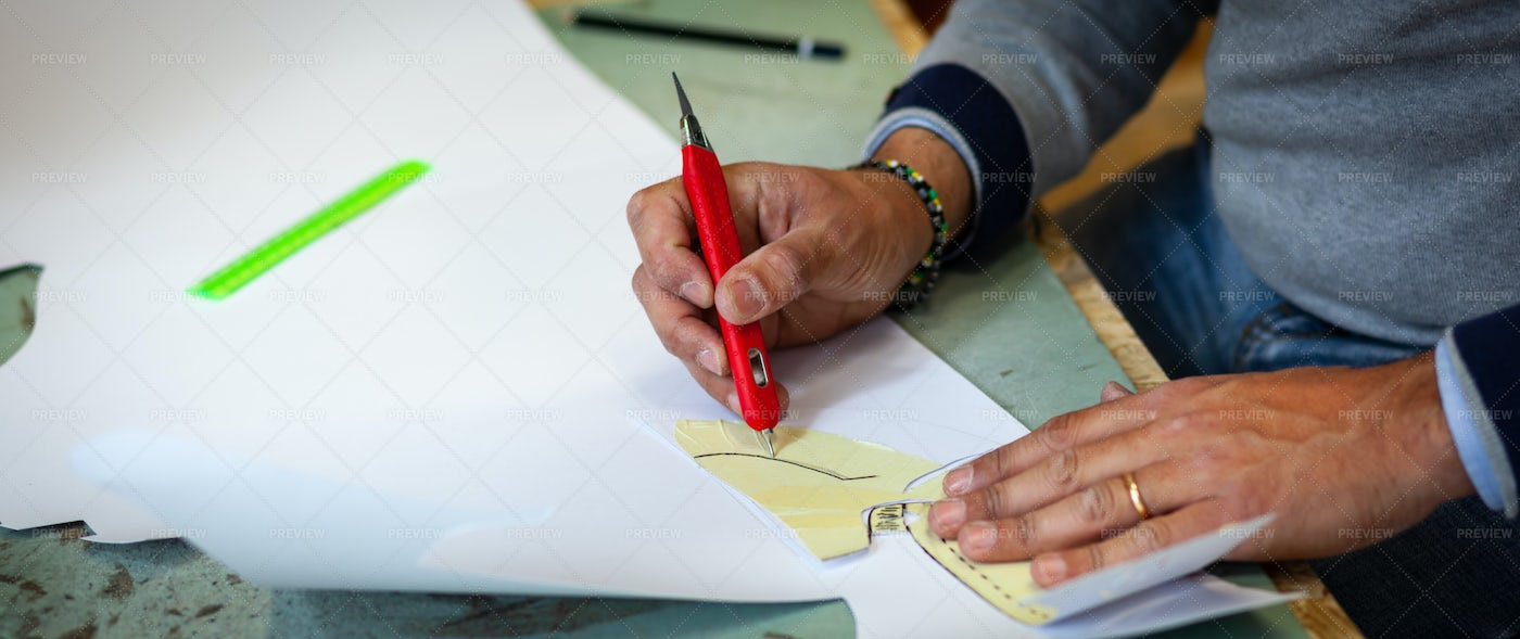 Shoe Designer With Paper Models: Stock Photos