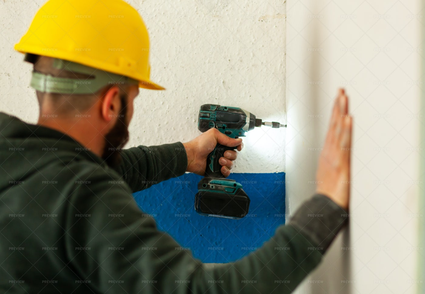Drilling Into A Wall: Stock Photos