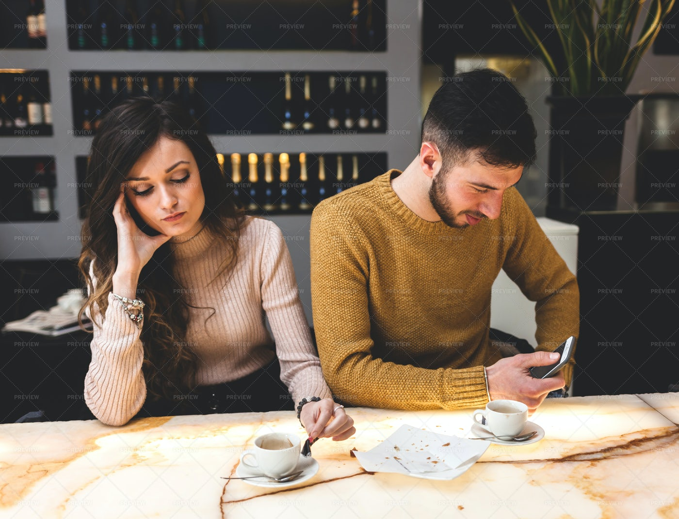 Sad Couple On A Bar: Stock Photos