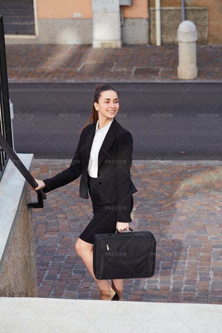 Businesswoman Walks The Steps: Stock Photos