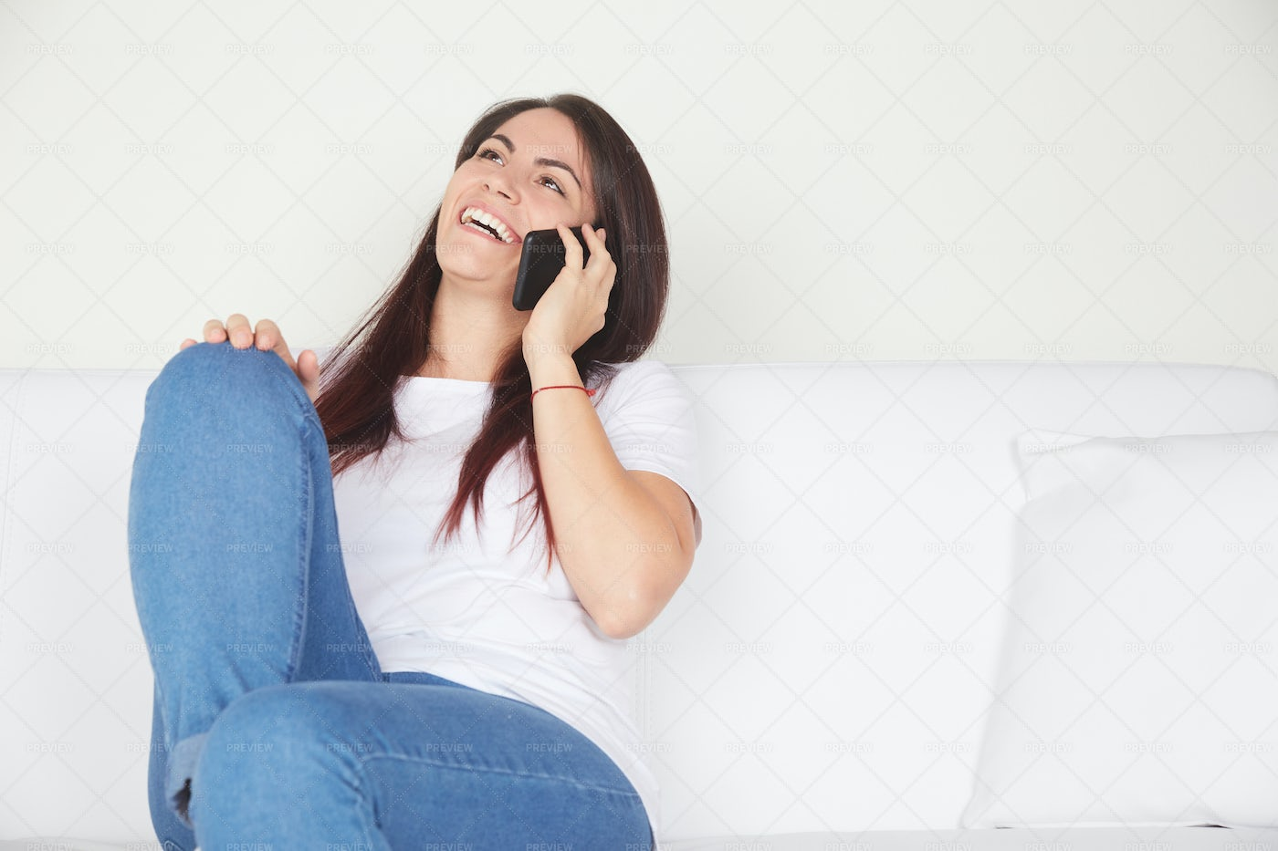 Phone Call On A Couch: Stock Photos