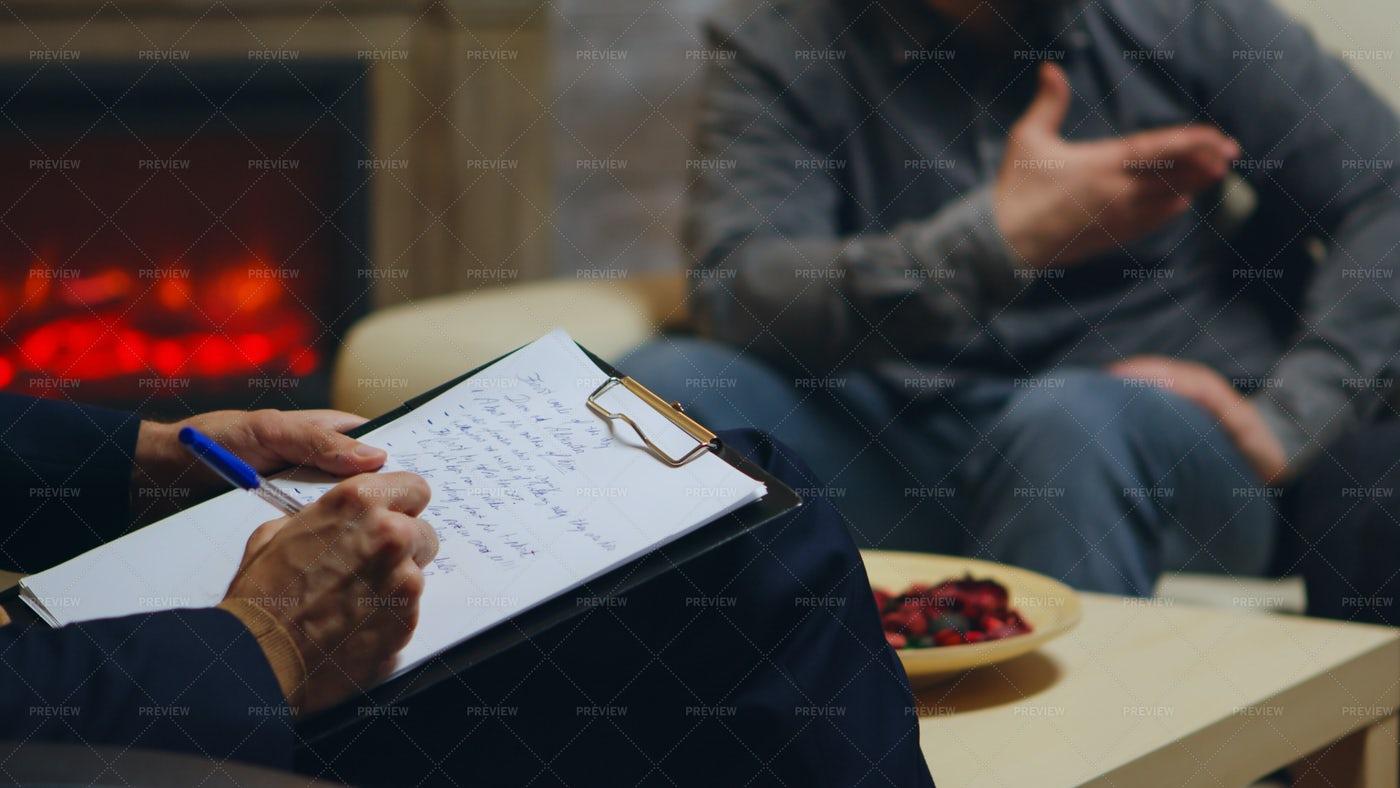 Therapist Writing Notes: Stock Photos